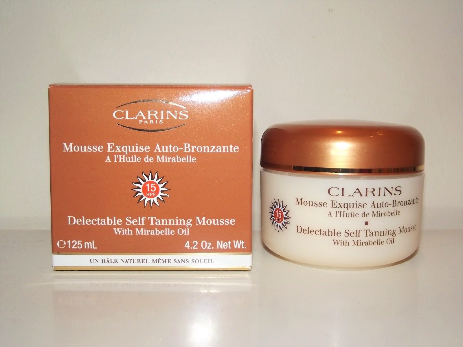 kem-chong-nang-clarins-suncare-delectable-self-tanning-mousse-spf-15-01