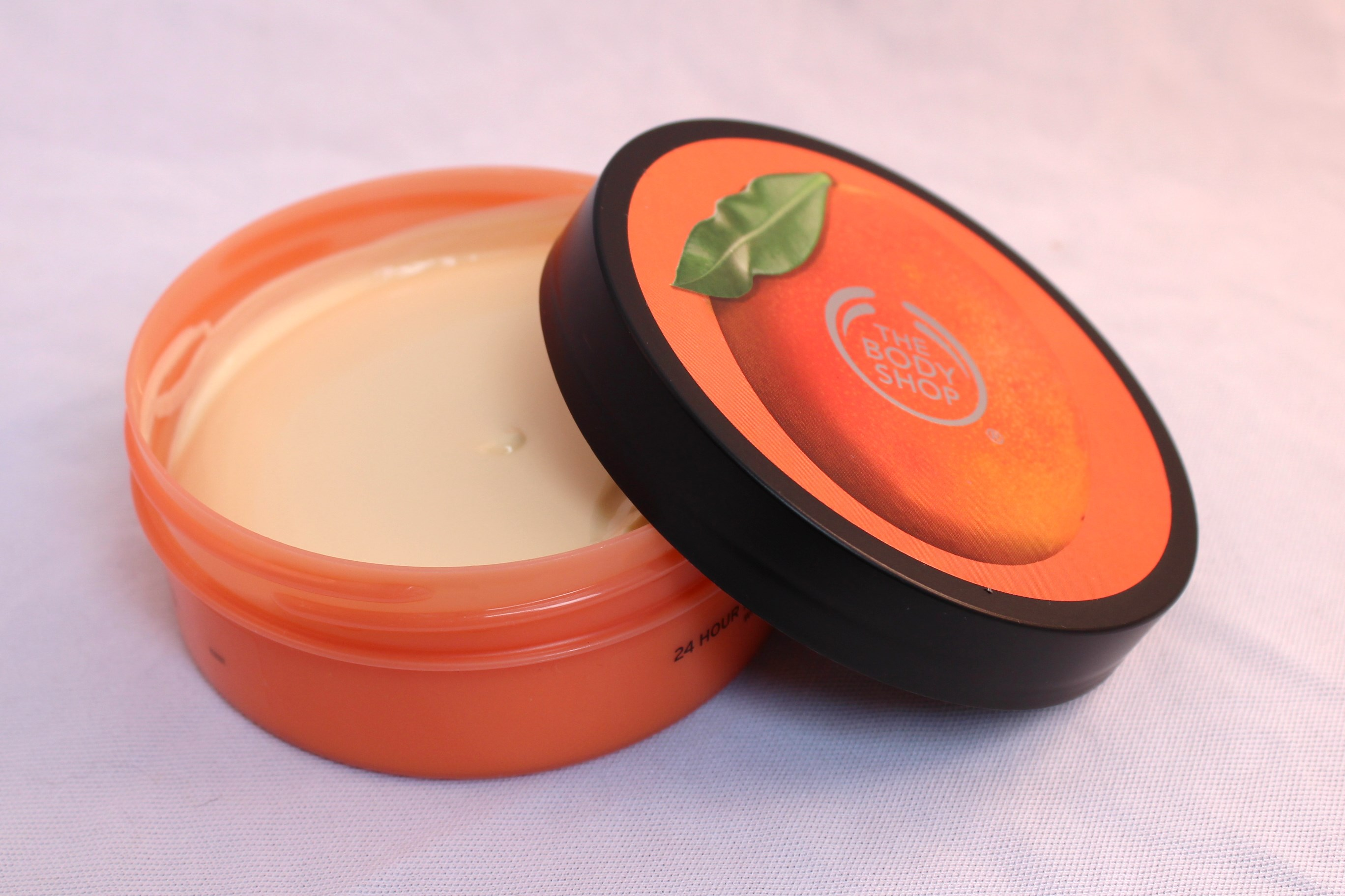dau-duong-thebodyshop-mango-softening-body-butter-05