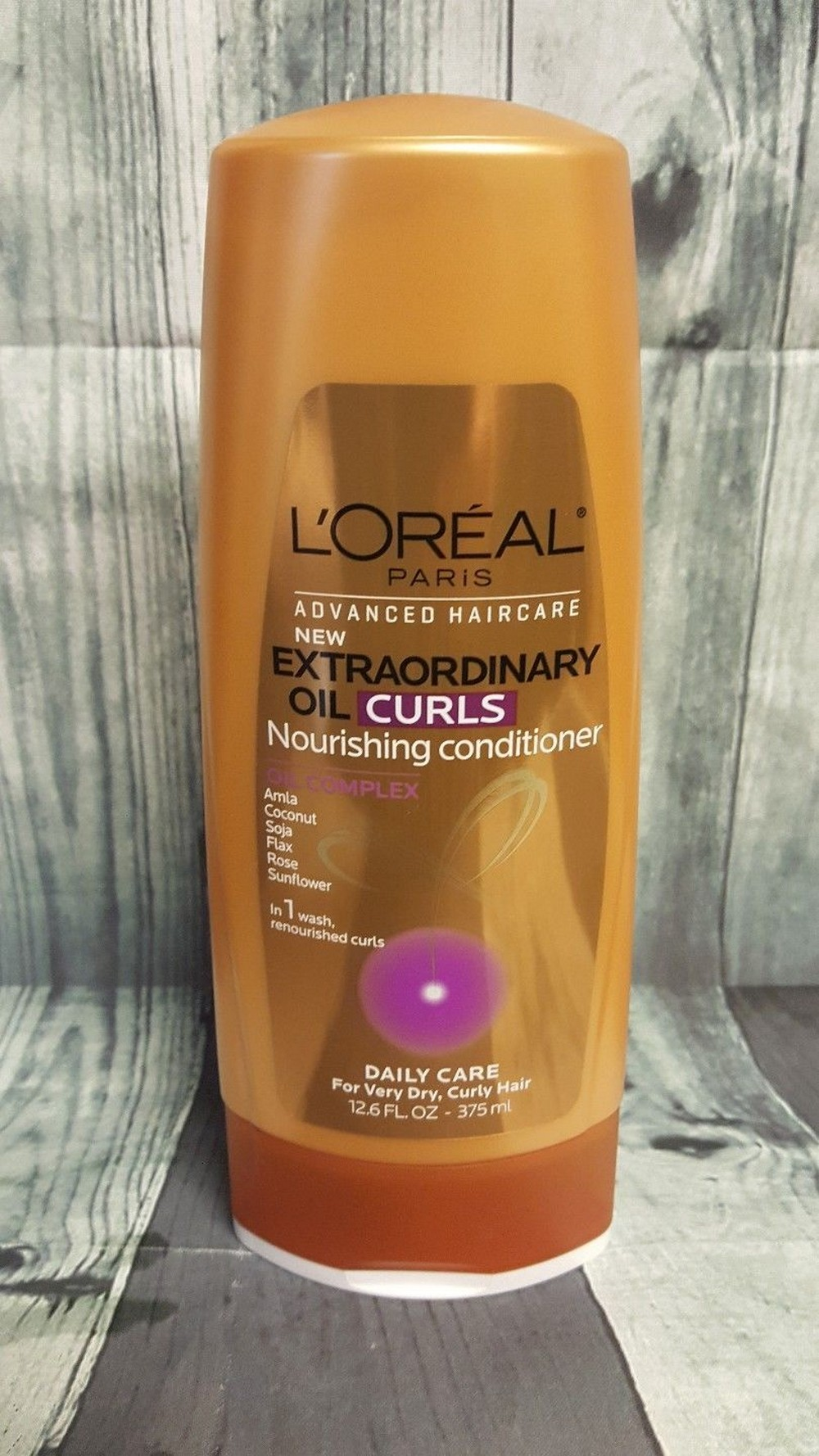 dau-xa-loreal-cham-soc-toc-extraordinary-oil-conditioner-02